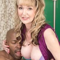 Uber-sexy grandma Janee Diamond seduces a younger black guy before sucking his BBC