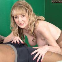 Beautiful grannie Janee Diamond sucks on a BIG EBONY PENIS after loosing her monster-sized titties