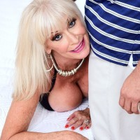 Spectacular granny Leah L'Amour deep throats and pulverizes a monster-sized dick while her husband sleeps