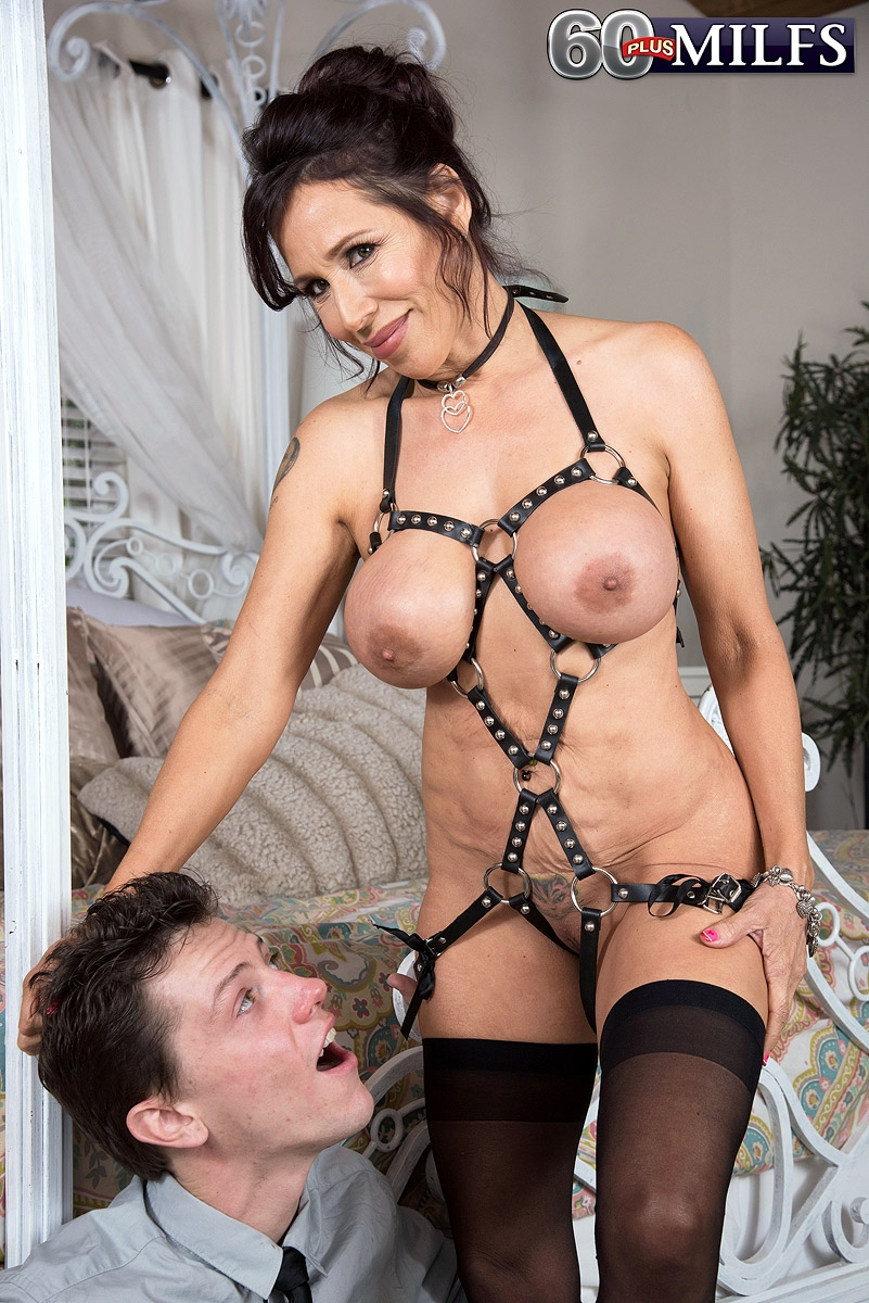 Jaw-dropping grannie Lisa Marie Heart tempts a younger dude in a choker and bondage harness