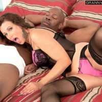Enticing grandma Mimi Moore gives a giant black dick a blowjob in enticing lingerie and nylons