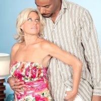 Fabulous grandmother Payton Hall is undressed to a pink thong by her junior black paramour