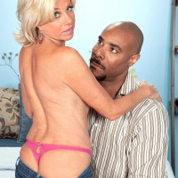 Phat grandma Payton Hall is unclothed to a pink thong by her younger ebony paramour