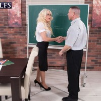 Foxy experienced lecturer Doll S entices a masculine student in a black micro-skirt and glasses