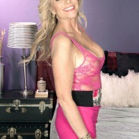 Hot aged dame Lauren Taylor entices a younger stud in a pinkish micro-skirt