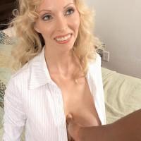 Foxy mature dame Ophelia Vixxxen sucks and penetrates a giant black sausage