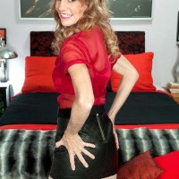 Sweet senior gal Denise Day entices a younger man in leather micro-skirt and nylons