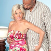 Fabulous accomplished woman Payton Hall is disrobed to thong panties by her junior black paramour