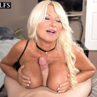 Inviting aged doll Annellise Croft has her large boobies munched on before a tit have sex