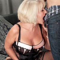 Fantastic senior gal Desire Collins seducing younger stud with huge cock in lingerie