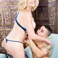 Gorgeous mature broad Kendall Rex letting gigantic boobs loose while seducing junior guy
