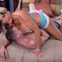 Inviting over Fifty MILF Sally D'Angelo flashing huge boobs while seducing boy for sex on bed