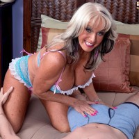 Tempting over 50 MILF Sally D'Angelo displaying huge titties while seducing guy for sex on bed