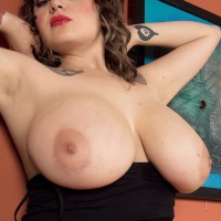 Provocative solo stunner Ariana Angel unveiling boobies adorned leg warmers and skirt