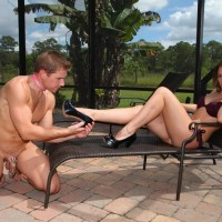 Spectacular girlfriend Callie Calypso makes her slave hubby worship her feet by a pool