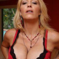 Killer girlfriend Charlee Pursue makes crossdressing sissy munch a strap on dick on his knees