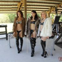 Isobel Raven and girlfriends humiliate and cane restrained masculine slave on restrain bondage table