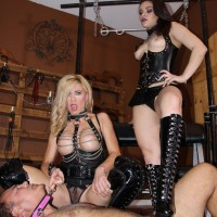 Kimber Forest and another woman in fetish wear trample a nude guy in black boots