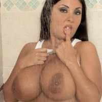Latina MILF Daylene Rio extracts her massive boobs from wet tee-shirt and boulder-holder