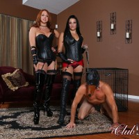 Leather outfitted Dommes Michelle & Lacy manhandling masked male slave in long boots