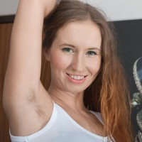 Leggy first-timer Nikky demonstrates her wooly underarms and cunt as she gets completely naked