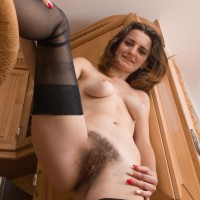 Long-limbed sandy-haired first-timer in pantyhose pulling out little knockers and hairy slit in heels