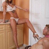 Long-legged blond wife Alexia Jordon has her slave man tongue her from behind