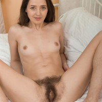 Tall dark haired first-timer Lisa Carry sliding panties over bum to unsheathe hairy honeypot