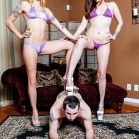 Lengthy legged women Sophia and Lucille make a slave boy sniff their bikini wearing butts