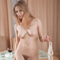 Skinny Euro amateur Abigail baring floppy boobies before letting out fur covered snatch from panties