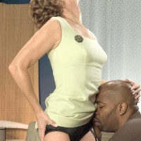 Spindly grandmother Avalynne O'Brien demonstrates upskirt panties while seducing a black man