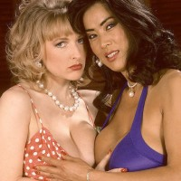 Sapphic pornographic stars Minka and Danni Ashe tongue smooch before rubbing massive tits and flashing panties