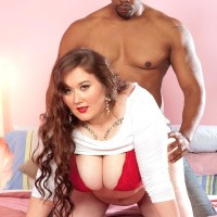 Lengthy haired BIG SEXY LADY Lilli Blue wanks on a BIG EBONY DICK after having her monster-sized ass and hooters liberated