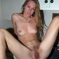 Leggy first-timer showcases off her furry armpits and all natural muff on top a bed