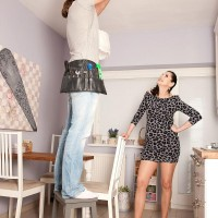 Tall cougar Lorenzia tempts the handyman in a short sundress and hosiery