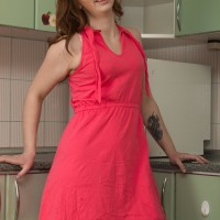 Long sock garbed first-timer Kira Fox letting out diminutive titties and furry cootchie in kitchen