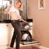 Marvelous mature broad revealing her sweet ass and fur covered pussy while peeling off denim jeans in a kitchen