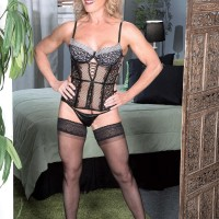 Older light-haired Amanda Verhooks welcomes her junior ebony paramour in enticing lingerie