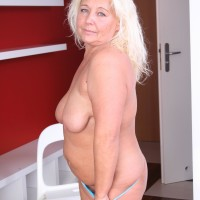 Aged fair-haired BIG HOT WOMAN stripping out of miniskirt and lingerie to pose plus-size ass in the naked
