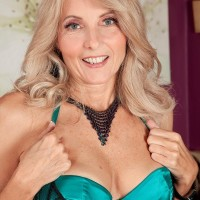 Senior sandy-haired Chery Leigh entices her younger paramour in gorgeous lingerie and nylons