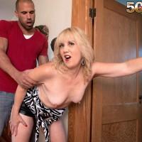 Senior blonde cougar Rebecca Williams seducing junior guy for sex on bed
