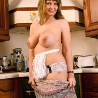 Aged platinum-blonde housewife lets her monster-sized all natural boobies free in her kitchen
