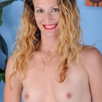 Expert golden-haired housewife sports red lips while undressing naked for the first time