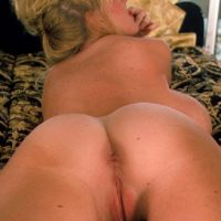 Experienced fair-haired Kayla Kleevage takes self shots of her tan lined ass in black stockings