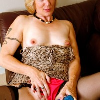 Elderly fair-haired broad hikes up her dress in order to toy her twat in black nylons