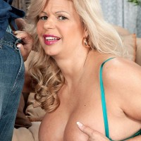 Aged ash-blonde doll Miss Deb whips out her big boobs from her lingerie on a futon
