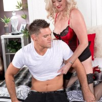 Experienced sandy-haired broad Val Kambel entices a junior dude in jaw-dropping lingerie and nylons