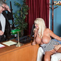 Mature fair-haired woman Annellise Croft flashing huge tits in front of cuckold