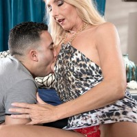 Elder yellow-haired woman Chery Leigh has her hard nips and beaver fellated on after seducing a youthful stud