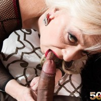 Experienced sandy-haired dame Heidi drains and tongues a immense ebony cock in a body-stocking
